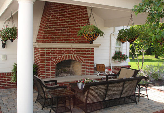 Outdoor fireplaces add a spark of drama to your landscape design and are a great place to entertain during any season. Bring the indoors out with the help of Peabody Landscape Group.