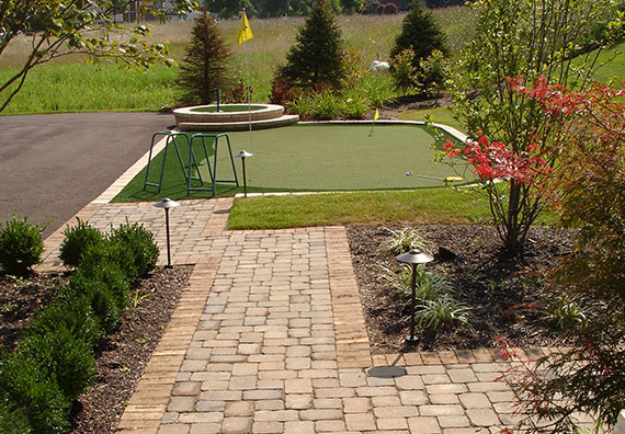 Putting Greens can give a homeowner a great place to practice their putting or just forget their stresses. Peabody Landscape Group can help you design a putting green that suits your style.