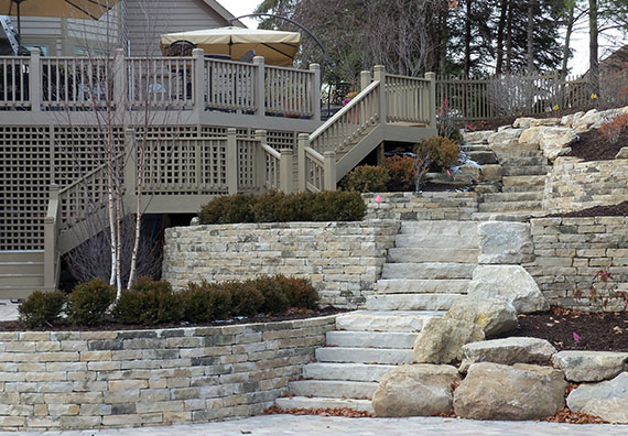 Peabody Landscape uses aesthetically pleasing stone retaining walls to control erosion and add a vertical appeal to landscape designs.