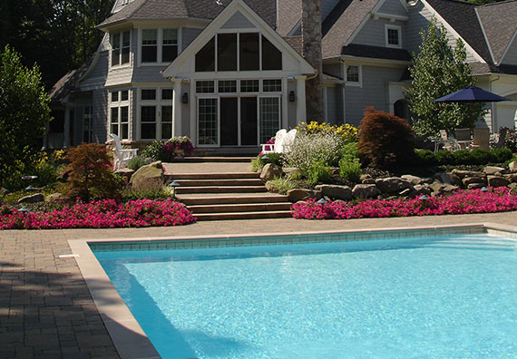 Create a relaxing atmosphere in your backyard with a well-planned swimming pool design from Peabody Landscape Group.