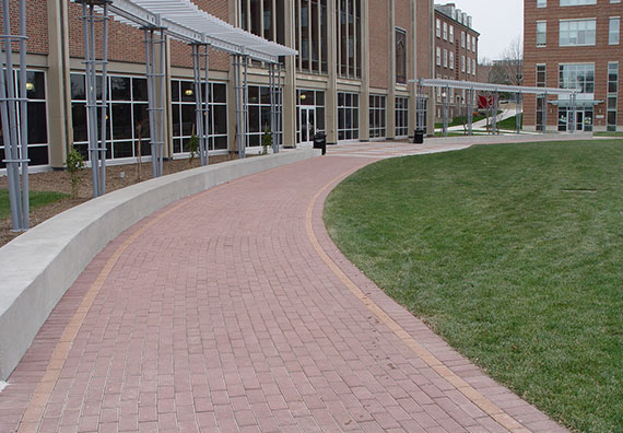 Brick and concrete pavers add a level of luxury to outdoor commercial spaces. Spruce up the look of your outdoors with help from Peabody Landscape Group.