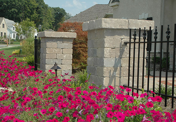 Mark the boundary lines of your property with a beatiful wood, vinyl or wrought iron fence from Peabody Landscape Group.